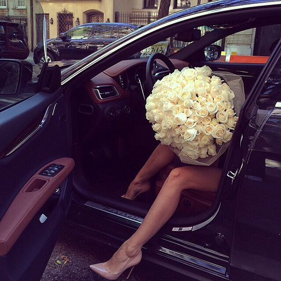 rich girl with flowers